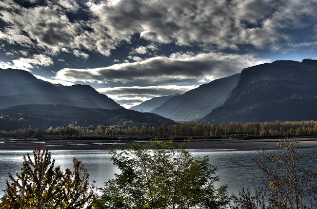 HDR photo of mountains across Lake Revelstoke