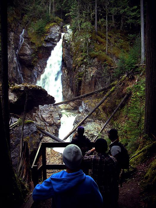 Hikers at Begbie Falls in Revelstoke, BC