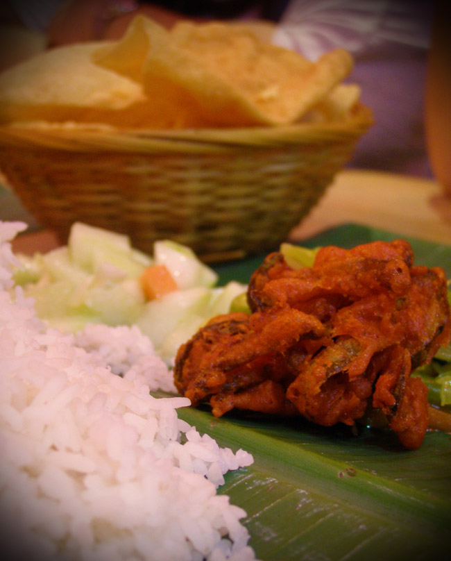 Delicious Indian food in KL served on a banana leaf