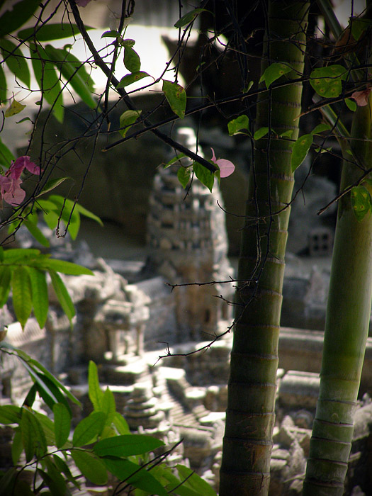 Angkor Wat miniature framed by vegetation