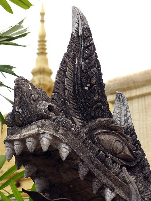Dragon sculpture in the Golden Stupa courtyard