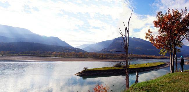 Panorama of a girl and Lake Revelstoke