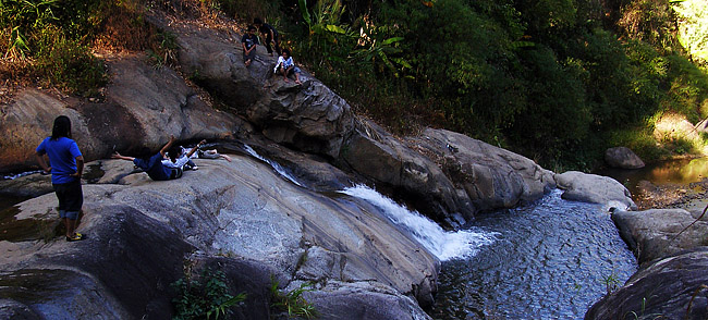 Natural waterslides at a waterfall in Pai
