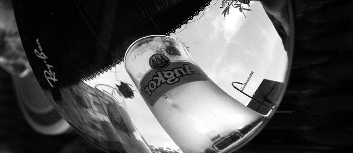 Angkor beer reflected in V's Ray Bans