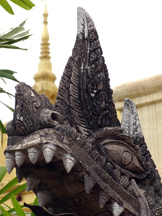 Dragon sculpture in the Golden Stupa courtyard
